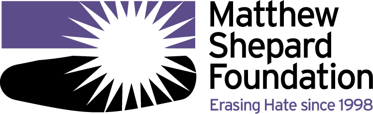 Thick purple bar above a thick black shape. Overlayed is an image of the sun, all set on a grey background. Text states Matthew Shepard Foundation Erasing Hate since 1998